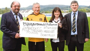 DFC Chairman Alan Jardine accepts £4k cheque from Trust Chair Denise Currie. Also pictured is Director Stephen Lynch and member George Tibbs/
